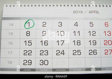 Mark a circle on the calendar date of April 1, the feast of fool's Day, laugh, humor, jokes. - Stock Photo