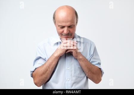 European bald man being tired. Sleepy guy at studio - Stock Photo