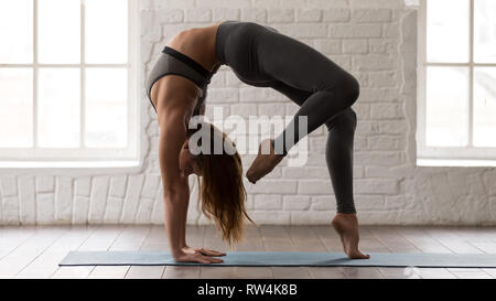 female gymnast standing in bridge pose and stretching out