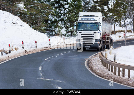 Kinlochleven truck vehicle travelling along A82 road on winter's day with snow around at Rannoch Moor, Glencoe, Highlands, Scotland in Winter - Stock Photo