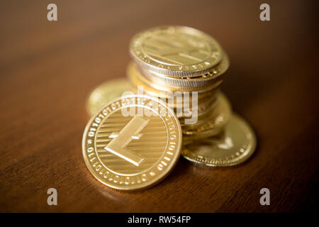 Business concept of crypto currency. Golden Lightcoin on us dollars close up. - Stock Photo