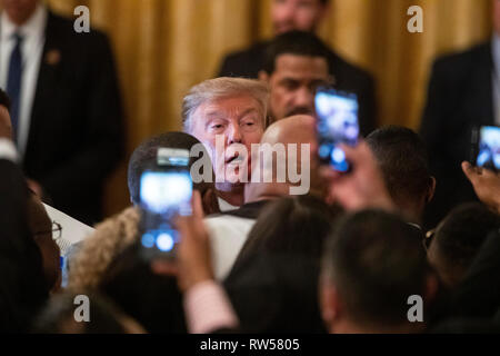 U.S. President Donald Trump greets guests after speaking at a National African American History Month reception at the White House in Washington, D.C., U.S., on Thursday, Feb. 21, 2019. - Stock Photo