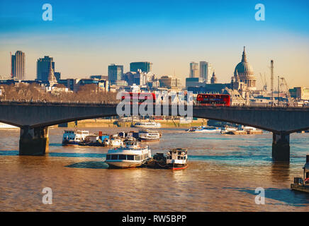 London, England, UK - February 25, 2019: Cityscape view with the Blackfriars bridge and famous Thames river in London in a daytime - Stock Photo