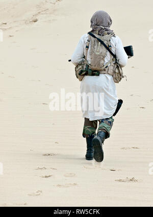 Muslim rebel with rifle. - Stock Photo