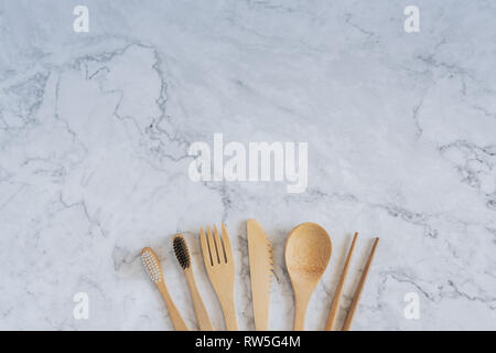 Bamboo wood toothbrush on clean white marble table top view background concept for save the earth day, world environmental, plastic free, kitchen flat - Stock Photo