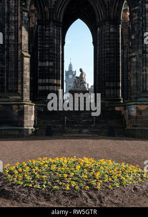 View through the Scott Monument towards the clock tower in the background on a sunny day, Edinburgh, Scotland - Stock Photo