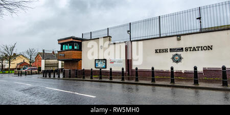 ENNISKILLEN, ULSTER / NORTHERN IRELAND - MARCH 03 2019 : The Kesh police station is protected by a huge fence a couple of days before the Brexit. - Stock Photo