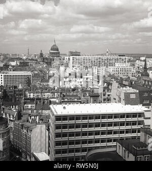 1960, London, view across the city, with St Pauls' Cathedral in the distance, still the tallest building in the capital at this time, despite the immediate post-war construction of modern buildings. In 1964 the BT Tower was built and became London's tallest building at 581ft when officially opened in 1965, due to the lifting of height restrictions on builings. - Stock Photo