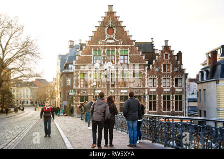 GENT, BELGIUM - FEBRUARY 17, 2019: young people admire the architecture of the old town - Stock Photo