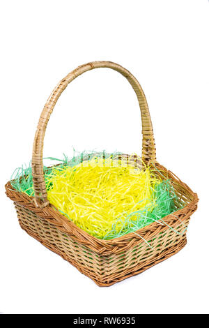 Wicker woven Easter basket isolated on white - Stock Photo