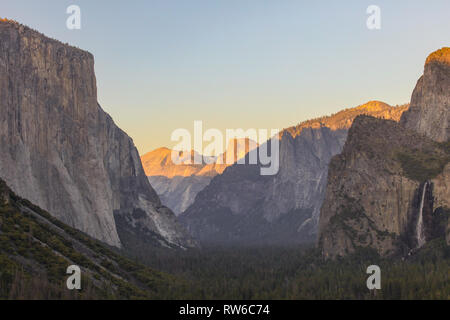 Beautiful View of Half Dome and El Capitan at Sunset from tunnel view look out. June of 2018. - Stock Photo