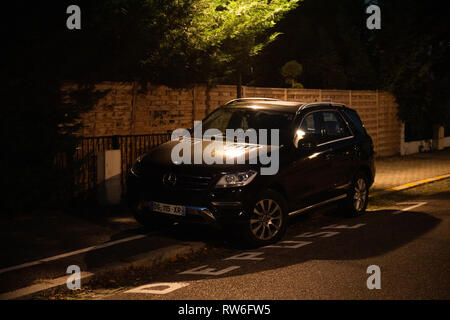 Strasbourg, France - Oct 13, 2018: French street at dusk with new Mercedes-Benz ML SUV black color - Stock Photo