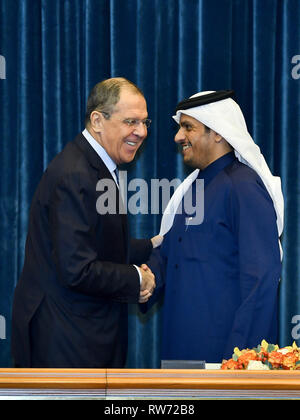 Doha, Qatar. 4th Mar, 2019. Russian Foreign Minister Sergei Lavrov (L) shakes hands with Qatari Deputy Prime Minister and Foreign Minister Sheikh Mohammed bin Abdulrahman Al-Thani after a joint press conference in Doha, Qatar, on March 4, 2019. The two foreign ministers on Monday discussed the latest developments in Syria and Libya. Credit: Nikku/Xinhua/Alamy Live News - Stock Photo