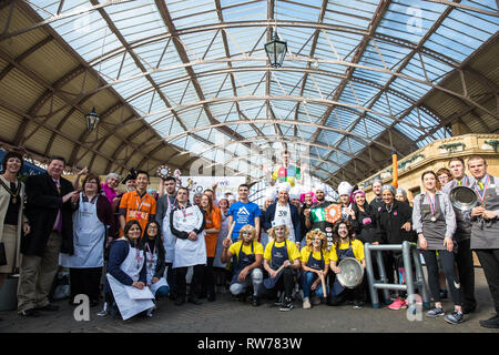 Windsor, UK. 5th Mar, 2019. Competitors in fancy dress on the theme of a '15th century housewife' from local businesses pose after taking part in the 13th Windsor and Eton Flippin' Pancake Challenge on Shrove Tuesday in aid of Alexander Devine Children's Hospice Service and Windsor Homeless Project. Credit: Mark Kerrison/Alamy Live News - Stock Photo