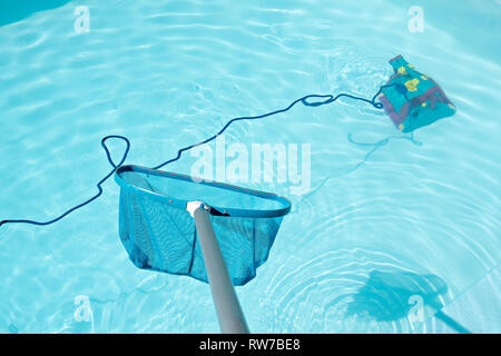 Pool Skimmer and underwater cleaning robot in swimming pool. Cleaning pool concept - Stock Photo