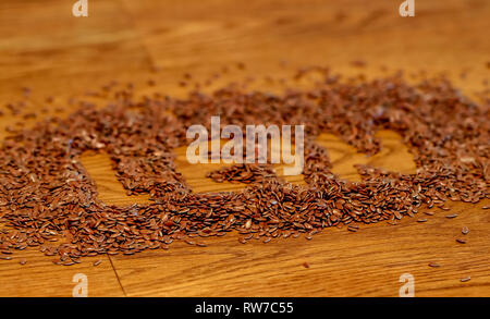 linseed closeup healthy living superfood, omega3 Leinsamen macro on dark wooden table - Stock Photo