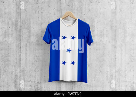 Honduras flag T-shirt on hanger, Honduran team uniform design idea for garment production. National wear. - Stock Photo
