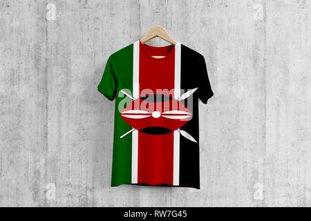 Kenya flag T-shirt on hanger, Kenyan team uniform design idea for garment production. National wear. - Stock Photo