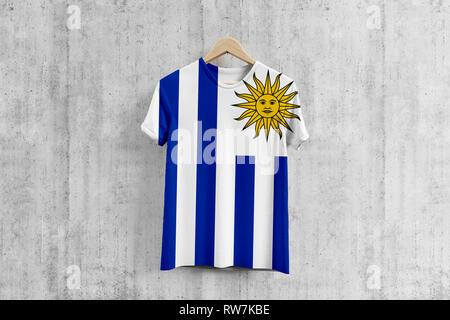 Uruguay flag T-shirt on hanger, Uruguayan team uniform design idea for garment production. National wear. - Stock Photo
