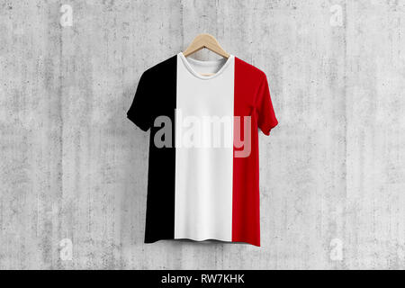 Yemen flag T-shirt on hanger, Yemeni team uniform design idea for garment production. National wear. - Stock Photo