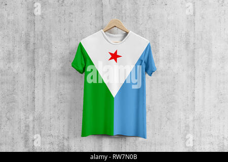 Djibouti flag T-shirt on hanger, team uniform design idea for garment production. National wear. 3D Rendering. - Stock Photo