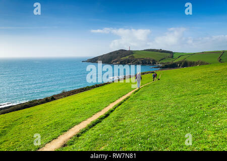 Editorial: Unknown members of the public & Logos. Fowey, St Austell, Cornwall, UK. 01/03/2019. Walkers trek the coastal path from Fowey to Gribbin. - Stock Photo