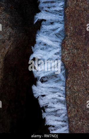 Hoarfrost formations on basalt - Stock Photo