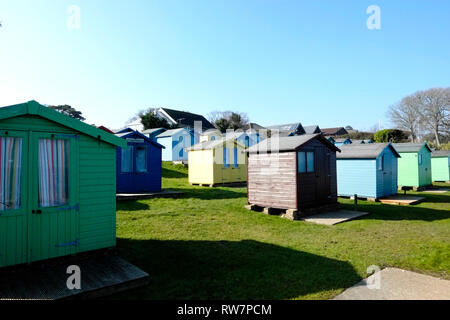 Colourful beach huts on the seafront at Bembridge beach, Bembridge Village, isle of Wight, England, UK. - Stock Photo
