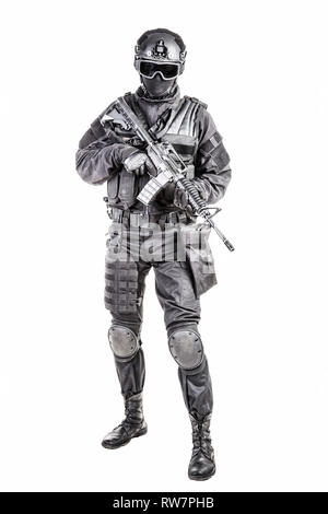 Spec ops police officer SWAT in black uniform and face mask. - Stock Photo