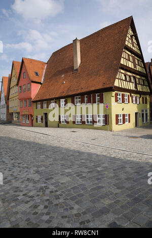 Gingerbread style commercial and residential apartment buildings in the medieval town of Dinkelsbuhl in late summer, Germany - Stock Photo