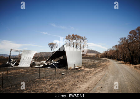 The aftermath and destruction left behind from bushfires in Bogolara Road, New South Wales, Australia. - Stock Photo