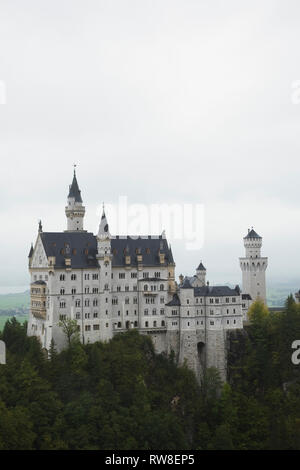 Neuschwanstein Castle built in the Romanesque Revival architectural style by King Ludwig II, Hohenschwangau, Bavaria, Germany - Stock Photo