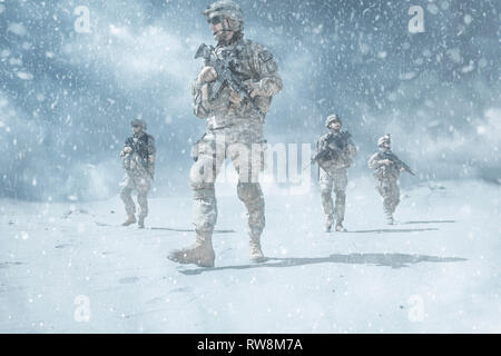 United States paratrooper airborne infantry in the desert snow storm. - Stock Photo