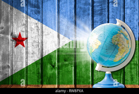 Globe with a world map on a wooden background with the image of the flag of Djibouti. The concept of travel and leisure abroad. - Stock Photo