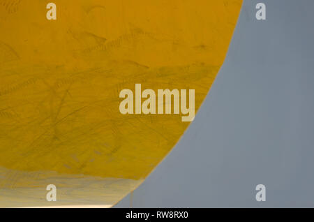Detail of skateboard area wall. Abstract colored background, play of light and shadow. Backdrop two tone yellow grey color, banner abstract - Stock Photo