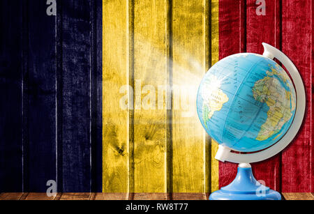 Globe with a world map on a wooden background with the image of the flag of Chad. The concept of travel and leisure abroad. - Stock Photo