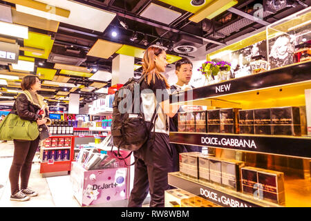 People shopping before departure in Duty-free shop at Vienna airport, Dolce & Gabbana - Stock Photo
