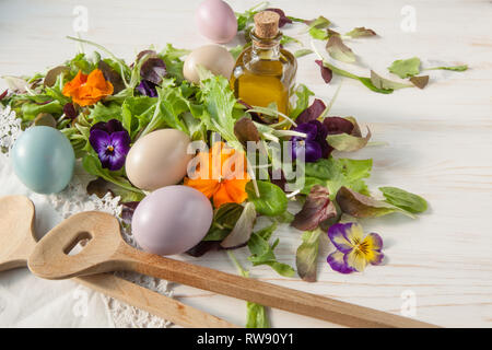 Lettuce and flower salad on woody white background spring, easter - Stock Photo