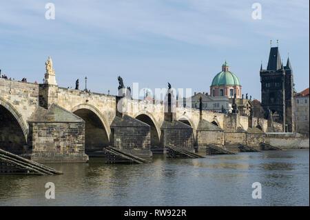 The Charles Birdge and Old Town Bridge Tower on the Vltava River in Prague (Praha), Czech Republic - Stock Photo