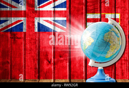 Globe with a world map on a wooden background with the image of the flag of Manitoba. The concept of travel and leisure abroad. - Stock Photo