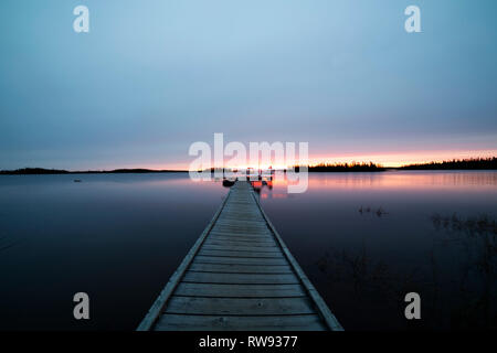 A float plane at the end of a jetty in Egenolf Lake in northern Manitoba, Canada. From the lake anglers fly in and fly out of nearby lodges. - Stock Photo