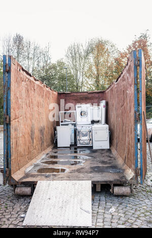 Old electrical appliances in container of recycling center  - Stock Photo