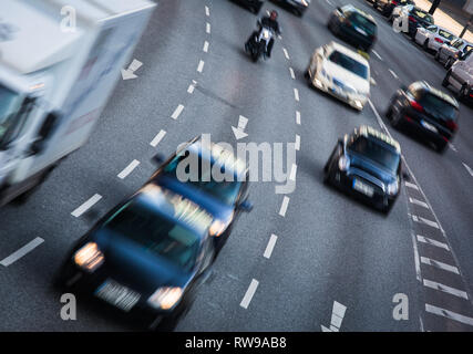 City streets with heavy traffic - motion blurred & color toned image - Stock Photo