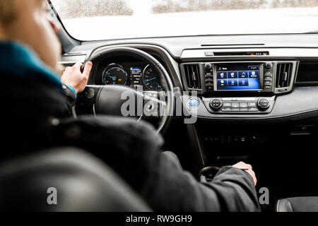 Close-up of Young man driving on the road.  - Stock Photo