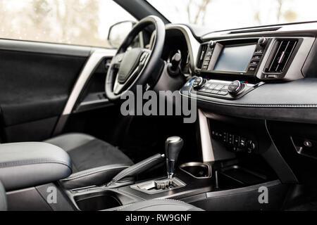 Luxury prestige car interior, dashboard, steering wheel.