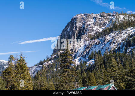 A tall ridge near Emigrant Gap (along I-80, in northern California) after some fresh snow in late winter. - Stock Photo