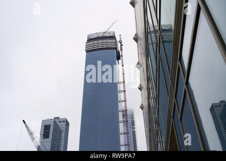 Skyscrapers under construction in Hudson Yards, New York City - Stock Photo