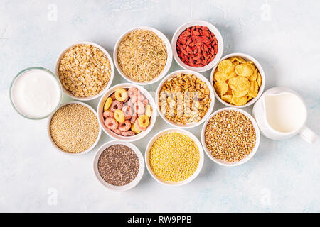 Ingredients for healthy breakfast - cereals, grains, seeds, dairy products. - Stock Photo