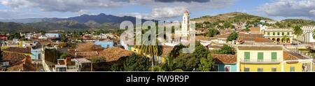 Wide Panoramic View of City Skyline, Bell Tower on Plaza Mayor and Colonial Houses in Trinidad, Cuba - a Unesco World Heritage Site - Stock Photo