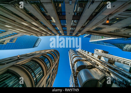 LONDON, UK - FEBRUARY 23, 2019: Upward view of  modern skyscrapers in the City of London, the heart of financial district in London. - Stock Photo